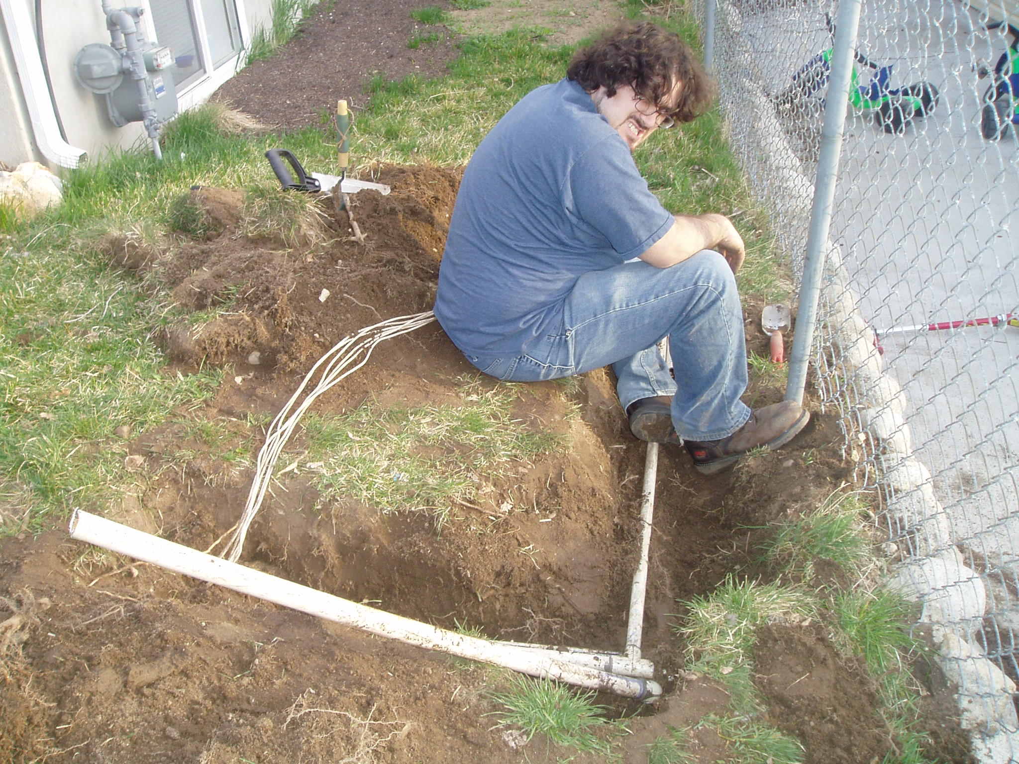 Yep, that's me working on the busted sprinkler line.
